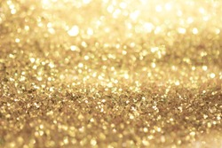Gold light Festive Christmas background. Abstract twinkled bright background with bokeh defocused golden lights