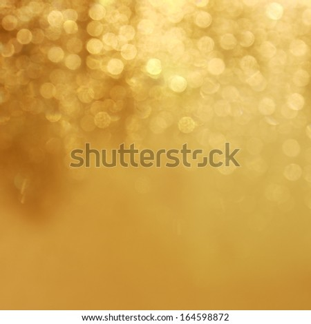 Gold lights background Beautiful shine of a holiday light