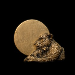 Gold lion. Handmade bronze sculpture miniature bas relief medal badge on black background.