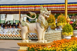 Gold lion statue from Cambodia, Asia. Buddist ancient symbol. Found in the Prince's Garden in Siem Reap. Guardian lions flank most Khmer temples. The lion, representing royalty, strength, and courage.