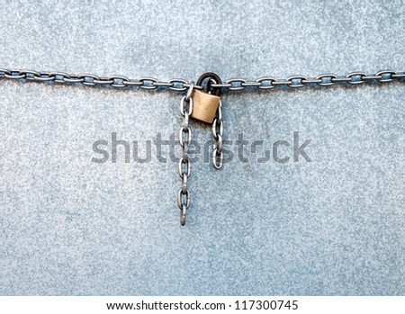 Gold lock chain fastens metal industrial box #117300745