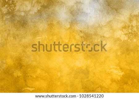 Gold luxury ink and watercolor textures on white paper background. Paint leaks and ombre effects.