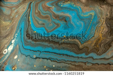 Gold marbling texture design. Blue and golden marble pattern. Fluid art.