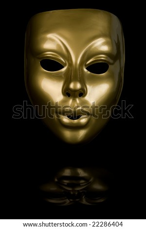 Gold mask isolated on black background