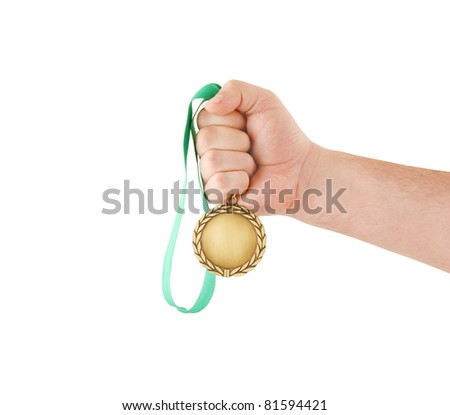 Gold medal in hand isolated on white