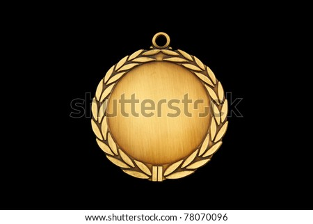 Gold medal isolated on black