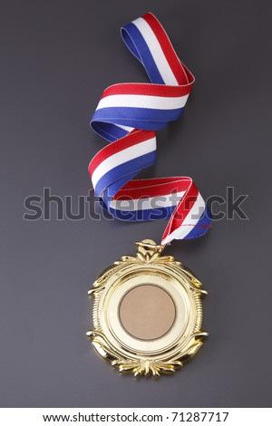 Gold medal isolated on the background.