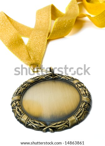 gold medal isolated over white. shallow dof
