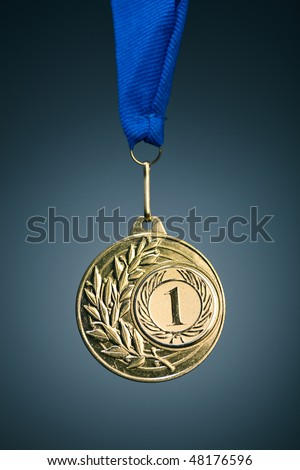 gold medal on blue