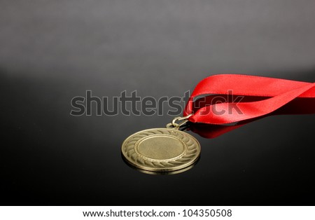 Gold medal on grey background