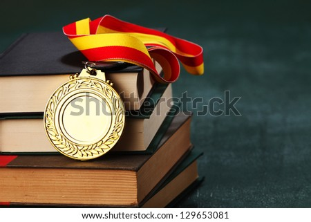 Gold medal on the book