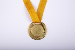 Gold medal on white background concept for winning or success