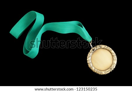 Gold medal with green ribbon isolated on black
