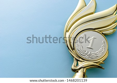 Gold medallion winners trophy with laurel wreath for the winner of a competition of championship event over grey with copy space #1468201139