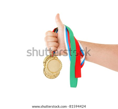 Gold medals in hand isolated on white