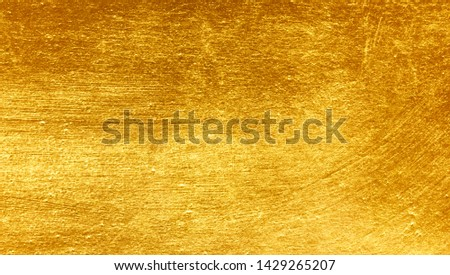 Gold metal brushed background or texture of brushed steel #1429265207