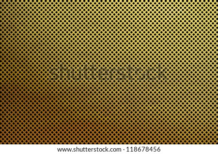 Gold metal plate with many small circular holes