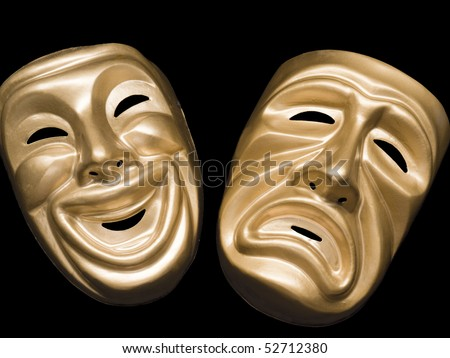 Gold metallic comedy and tragedy masks on black