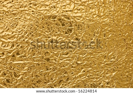 Gold metallic crumpled paper texture for background.