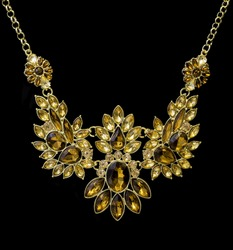 Gold necklace decorated with brown gemstones