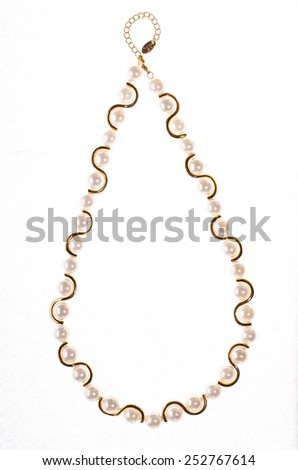 gold necklace with pearls on a white background #252767614