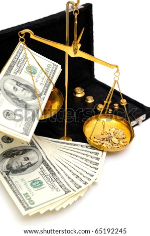 Gold nuggets in the pan of a balance scale with many fifty and hundred dollar bills showing the value of both - stock photo