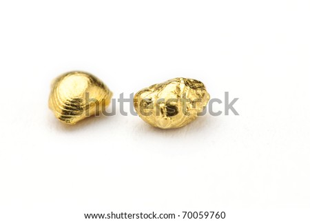 Gold nuggets isolated against a white background