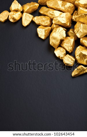 gold nuggets on a black background. closeup.
