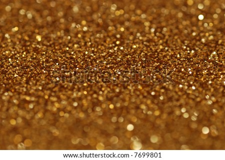 Gold nuggets sparkling carpet. Close-up view, shallow deep of field - stock photo