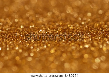 Gold nuggets sparkling carpet. Close-up view, very shallow deep of field