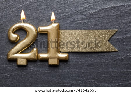 Gold number 21 celebration candle with glitter label