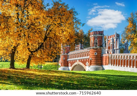 Gold of autumn trees at the Figurine Bridge in Tsaritsyno in Moscow