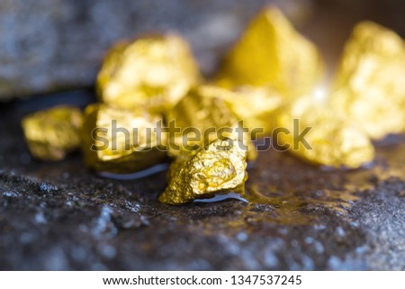 Gold on the stone floor Discovering Success and Investing Concepts with Business Partners. #1347537245