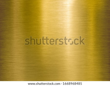 Gold or brass brushed metal background or texture Foto stock ©