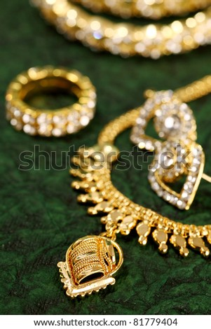 Gold ornaments on textured background.