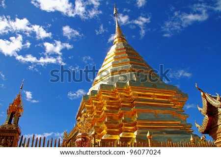 Gold pagoda and castle at Wat Phra That  Doi Suthep, are county  Chiang Mai, Thailand. The golden pagoda contains the Holy Buddha Relic