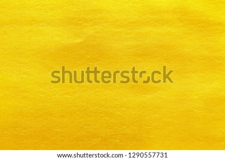Gold paint on cement wall texture #1290557731