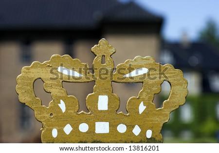 Gold Painted Crown outside Royal Rosenborg Castle in Copenhagen, Denmark - stock photo