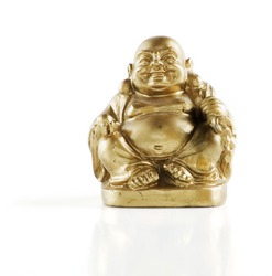 Gold painted laughing buddha figurine isolated against a white background.
