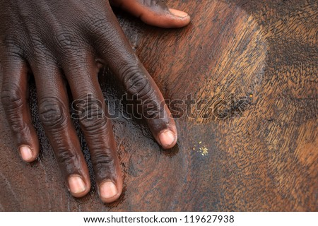 Gold panning, close up, gold and hand