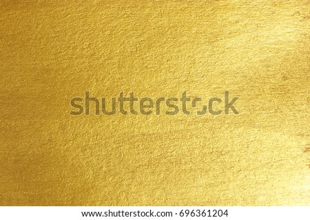 Photo of  Gold paper background Golden paper surface as background