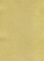 Gold paper texture background. Vertical format. Free space for your text. Gold sparkling festive background, close-up. Fine round texture. Granular texture of an egg shell