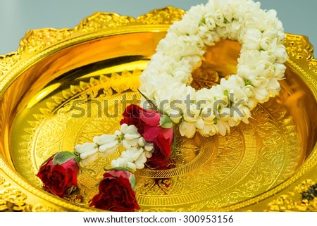gold pedestal with thai Flower Garland with jasmine & roses as sign of respect (flower garland for religious ceremonies Thailand tradition marriage, Songkran festival, Mother day) #300953156