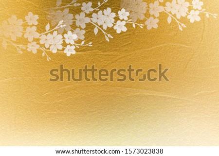gold petals background with cherry petals
