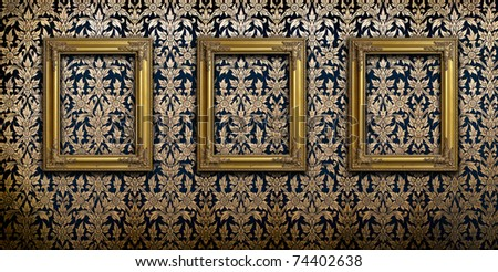 Gold picture frame on Thai traditional pattern wall