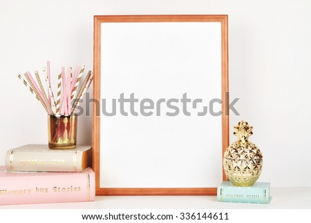 gold picture frame with decorations. Mock up for your photo or text Place your work, print art,shabby style, white background, pastel color book, gold pine