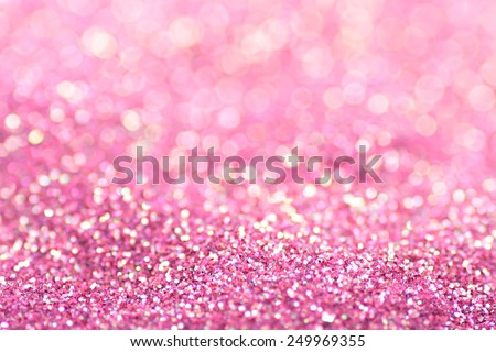 Gold pink nuggets sparkling carpet. Close-up view, very shallow deep of field . Macro.