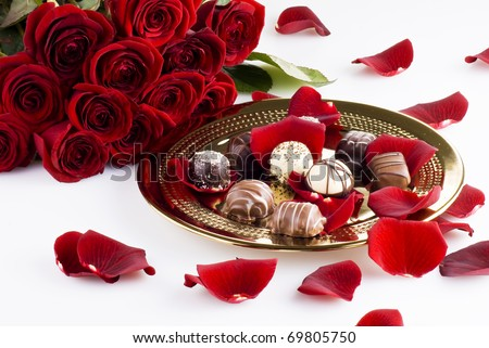 Gold plate of luxury chocolates with red roses