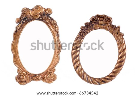 Gold plated and richly decorated frame on a white background. Golden vintage picture frame on white Ornamented, very old, gold plated empty picture frame for putting your pictures in