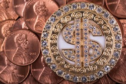 Gold plated medallion with pseudo-precious stones and dollar symbol and American coins in denominations of 1 cent